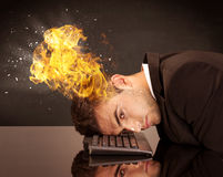 Stressed business man`s head is burning Stock Images