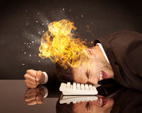 Stressed business man`s head is burning Royalty Free Stock Photo