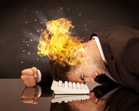 Stressed business man`s head is burning Royalty Free Stock Image