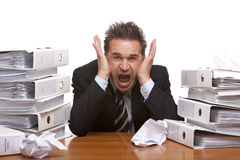 Stressed business man screams frustrated in office Royalty Free Stock Images