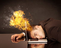Stressed business man's head is burning Royalty Free Stock Photography