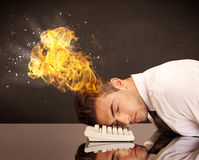 Stressed business man's head is burning Royalty Free Stock Image
