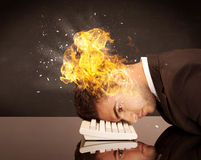 Stressed business man's head is burning Royalty Free Stock Photo