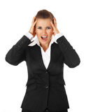 Stressed business woman. Stressed modern business woman isolated on white background royalty free stock photo