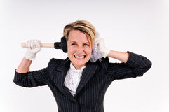Stressed business woman. In rubber gloves plugging her ears with cleaning stuff Stock Images