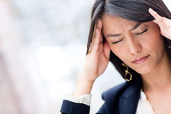 Stressed business woman Stock Photo