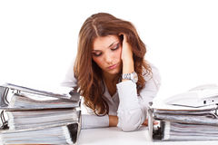 Stressed business woman. Sitting behind the desk Royalty Free Stock Image