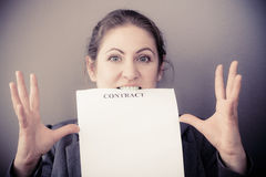 Stressed business woman biting contract Stock Photography