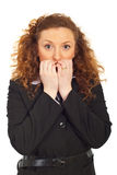 Stressed business woman biting nails Royalty Free Stock Image