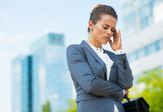 Stressed business woman with briefcase. In office district Royalty Free Stock Images