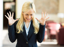 Stressed business woman in corporate office Stock Images