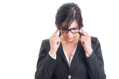 Stressed business woman having a headache Royalty Free Stock Images