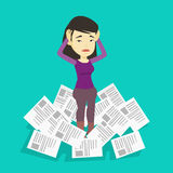 Stressed business woman having lots of work to do. Royalty Free Stock Images