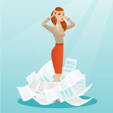 Stressed business woman having lots of work to do. Royalty Free Stock Photo