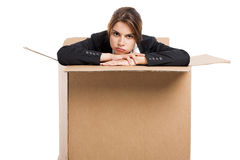 Stressed business woman inside a card box Stock Photos