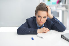 Stressed business woman near flipchart. In office Royalty Free Stock Images