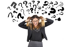 Stressed business woman question marks above head. Pulling hair Royalty Free Stock Photos