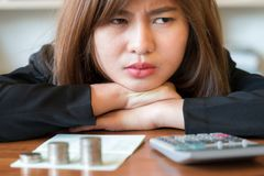 Stressed business woman running out of money - stock and market. Down Royalty Free Stock Image