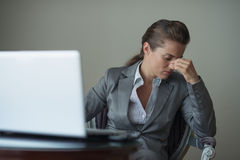 Stressed business woman sitting in hotel room Royalty Free Stock Photography