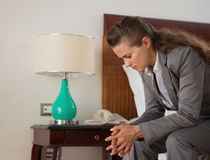 Stressed business woman sitting in hotel room Royalty Free Stock Photos