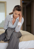 Stressed business woman sitting in hotel room Royalty Free Stock Images