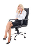 Stressed business woman sitting on office chair  isolated on whi. Te background Stock Photo