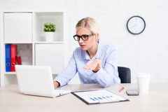 Stressed business woman sitting in office having problems with c Stock Photo