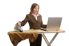Stressed business woman working - isolated Stock Photography