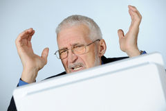 Stressed businessman. Horizontal image of stressed senior businessman stock image