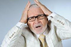 Stressed businessman. Horizontal image of stressed senior businessman Royalty Free Stock Image