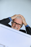 Stressed businessman. Vertical image of stressed businessman Stock Photography