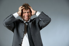 Stressed businessman. Portrait of young stressed businessman Stock Image