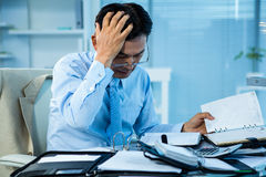 Stressed businessman with a big amount of work. In office stock images