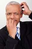 Stressed Businessman Biting His Nails Stock Photography