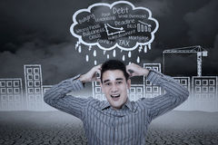 Stressed businessman with building background Royalty Free Stock Images