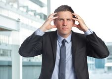 Stressed businessman in business district Stock Images