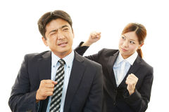 Stressed businessman and business woman Royalty Free Stock Image
