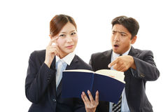 Stressed businessman and business woman Stock Photos