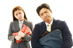 Stressed businessman and business woman Royalty Free Stock Images