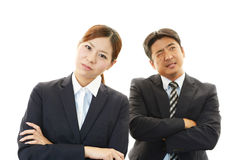 Stressed businessman and businesswoman Stock Photo