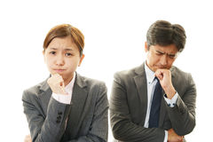 Stressed businessman and businesswoman Stock Photos