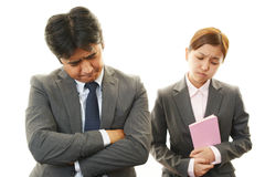 Stressed businessman and businesswoman Stock Photography