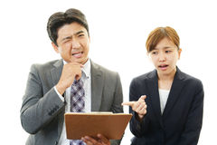Stressed businessman and businesswoman Royalty Free Stock Images