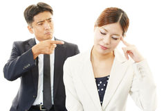 Stressed businessman and businesswoman stock image