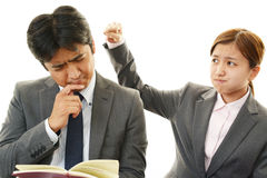Stressed businessman and businesswoman Stock Images