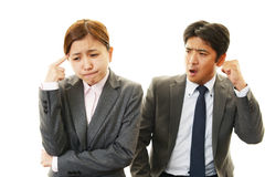 Stressed businessman and businesswoman Royalty Free Stock Image