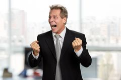 Stressed businessman clenched fists in desperation. Furious shouting man wearing formal wear in full despair. Mad frustrated executive stock image