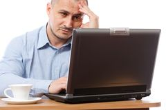 Stressed businessman at computer Royalty Free Stock Photography