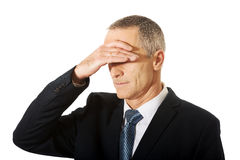 Stressed businessman covering his face Stock Image