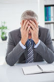 Stressed businessman covering his face Stock Photos